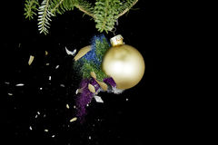 Christmas ball exploding. Colored glitters falling. Royalty Free Stock Image