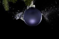 Christmas ball exploding. liquid splashing out. Royalty Free Stock Photo