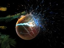 Christmas ball exploding while on the tree royalty free stock photo