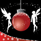 Christmas Ball with Fairy. Christmas ball with two fairies beside the ball Royalty Free Stock Image