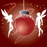 Christmas Ball with Fairy. Christmas ball with two fairies beside the ball Stock Photography