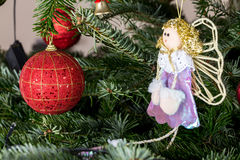 Christmas ball and fairy doll. Royalty Free Stock Image