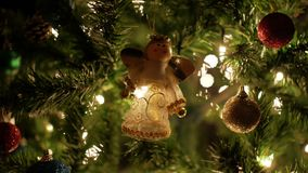 Christmas ball, fairy garland on Christmas tree with bokeh lights.  stock footage