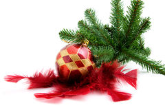 Christmas ball with feathers and tree Stock Photo