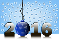 2016 and christmas ball. 2016 figures and Christmas ball glass reflection on the background of snowflakes Royalty Free Stock Image