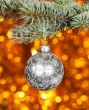 Christmas ball on fir branch Royalty Free Stock Photos