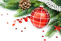 Christmas ball and fir branches with decorations Royalty Free Stock Photos