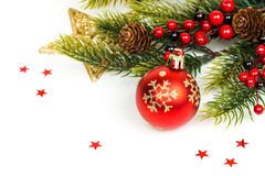 Christmas ball and fir branches with decorations Stock Photos