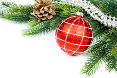 Christmas ball and fir branches with decorations Royalty Free Stock Photo
