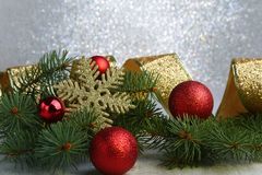Christmas ball and fir branches with decorations isolated over white.  Stock Images