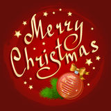 Christmas ball and fir branches with lettering Stock Photo