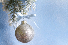 Christmas ball on fir branches and snowy blue background Royalty Free Stock Photography