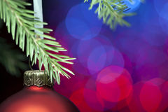Christmas ball on fir tree. New Year decoration on snow-covered Royalty Free Stock Images