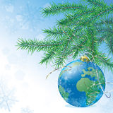 Christmas ball in form of the globe Royalty Free Stock Photos