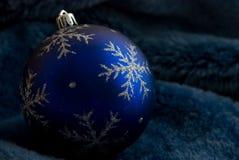 Christmas ball on fur. Blue christmas ball on fur royalty free stock photography
