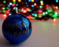 Christmas ball and garland. Christmas ball and electric garland on the table Royalty Free Stock Image