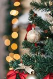 Christmas ball and garland on the fir tree Royalty Free Stock Images
