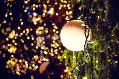 Christmas ball and garland on shiny background Royalty Free Stock Images