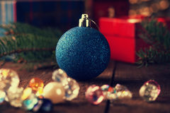 Christmas ball, gift box and fir tree branch Royalty Free Stock Images