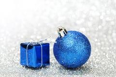 Christmas ball and gift Stock Image