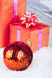 Christmas ball and gifts Royalty Free Stock Photos