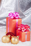 Christmas ball and gifts Royalty Free Stock Image