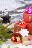 Christmas ball and gifts Stock Images