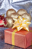 Christmas ball and gifts Royalty Free Stock Photo