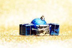 Christmas ball and gifts Royalty Free Stock Images