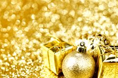 Christmas ball and gifts Royalty Free Stock Image