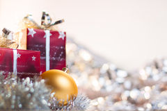 Christmas ball and gifts on light background Stock Photos