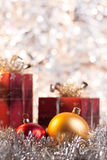 Christmas ball and gifts on light background Stock Photography