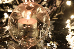 Christmas ornament, ball of glass, lights and silver. Christmas ornament, ball with lights and silver background royalty free stock image