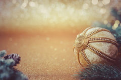 Christmas ball on glitter background. Vintage Christmas ball ornament on glitter background. Shallow depth of field, copy space stock photo