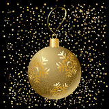 Christmas ball. Glitter Christmas gold ball with snowflakes and golden confetti falling, black background. Vector card for Merry Christmas and New Year Holiday Stock Photo