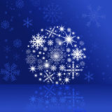 Christmas ball on the glossy blue background. Royalty Free Stock Photography