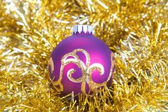 Christmas ball in gold decorations Royalty Free Stock Photography