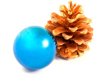 Christmas ball with a gold pine cone Stock Images
