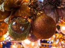Christmas ball. Gold sparkling christmas ball on christmas tree Stock Photos