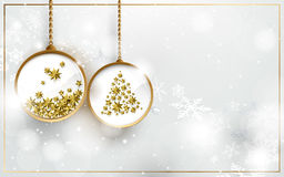 Christmas ball with gold stars on white snowflakes background Stock Image