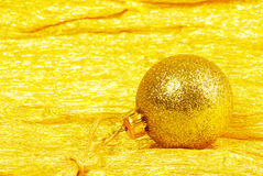 Christmas ball on golden Royalty Free Stock Images