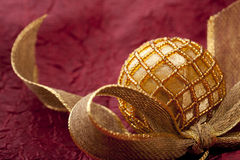Christmas ball with golden ribbon Royalty Free Stock Photo