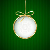 Christmas ball on green background. Green Christmas background with ball and golden ribbon, illustration Stock Images