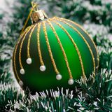Christmas Ball on green garland Stock Images