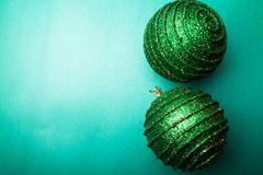 Christmas ball on green pepper backround.Christmas greeting card. Merry Christmas. Top view. Copy space. Minimalism concept. Royalty Free Stock Photography