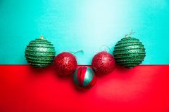 Christmas ball on green and red pepper backround.Christmas greeting card. Merry Christmas. Top view. Copy space. Minimalism concep Royalty Free Stock Photography