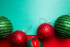 Christmas ball on green and red pepper backround.Christmas greeting card. Merry Christmas. Top view. Copy space. Minimalism concep Royalty Free Stock Images