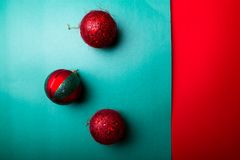 Christmas ball on green and red pepper backround.Christmas greeting card. Merry Christmas. Top view. Copy space. Minimalism concep Royalty Free Stock Photo