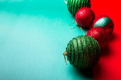 Christmas ball on green and red pepper backround.Christmas greeting card. Merry Christmas. Top view. Copy space. Minimalism concep Stock Images