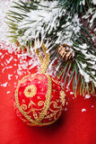 Christmas ball and green spruce branch Royalty Free Stock Image